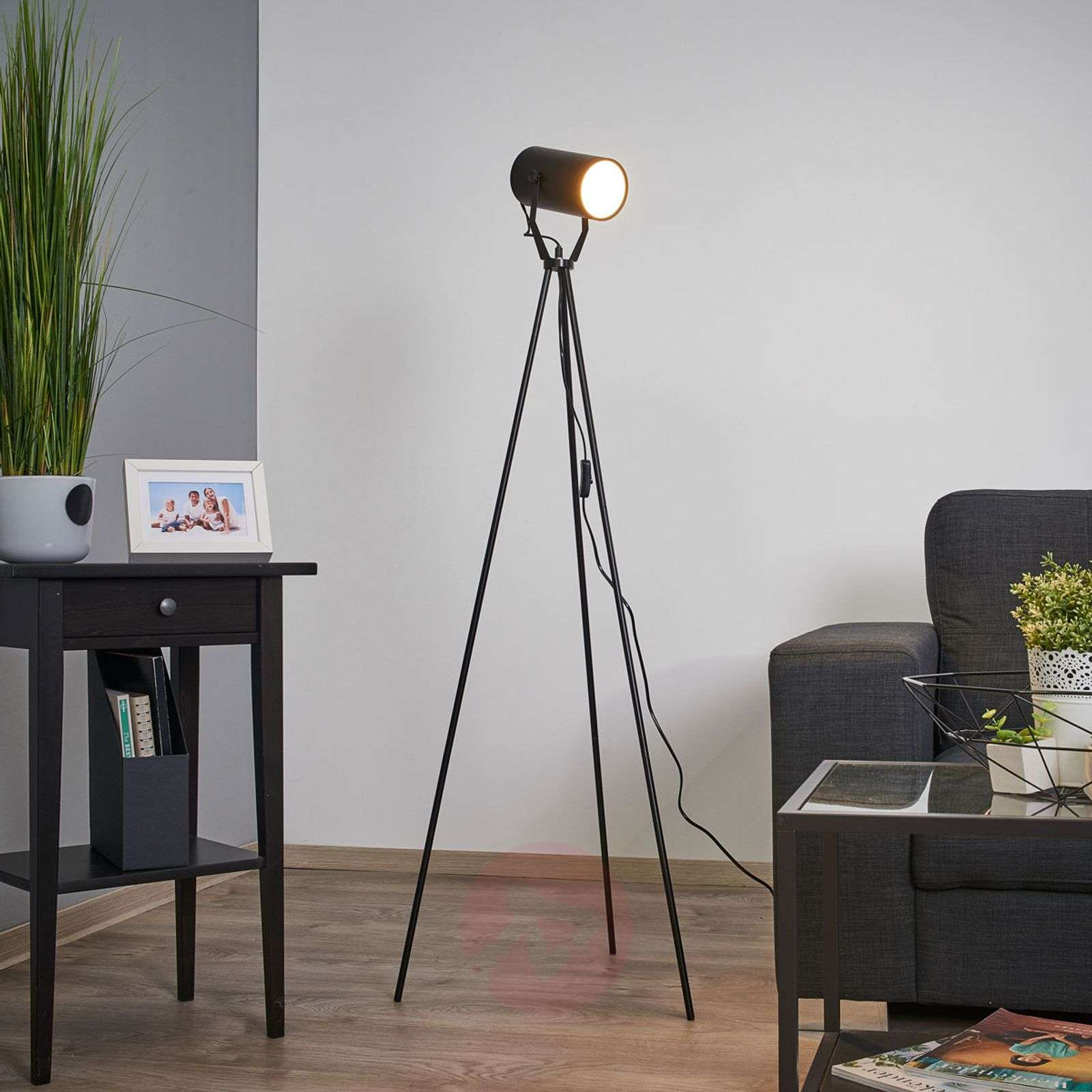 Pulse LED table lamp with a tripod frame | Lights.co.uk
