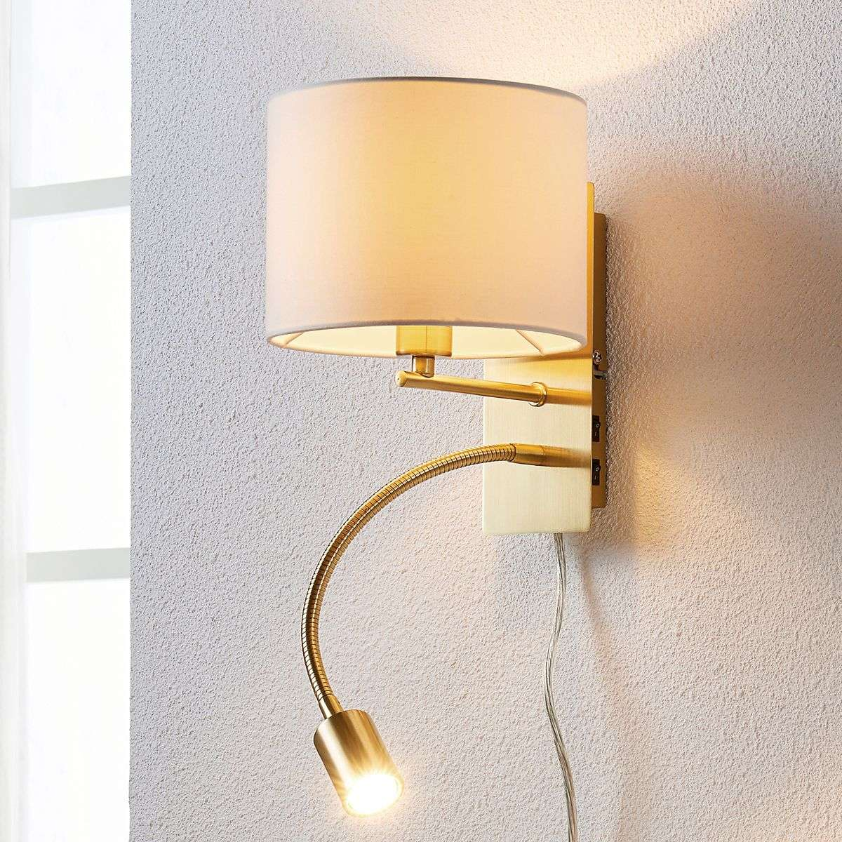 Brass-coloured wall lamp Florens LED reading light Lights.co.uk